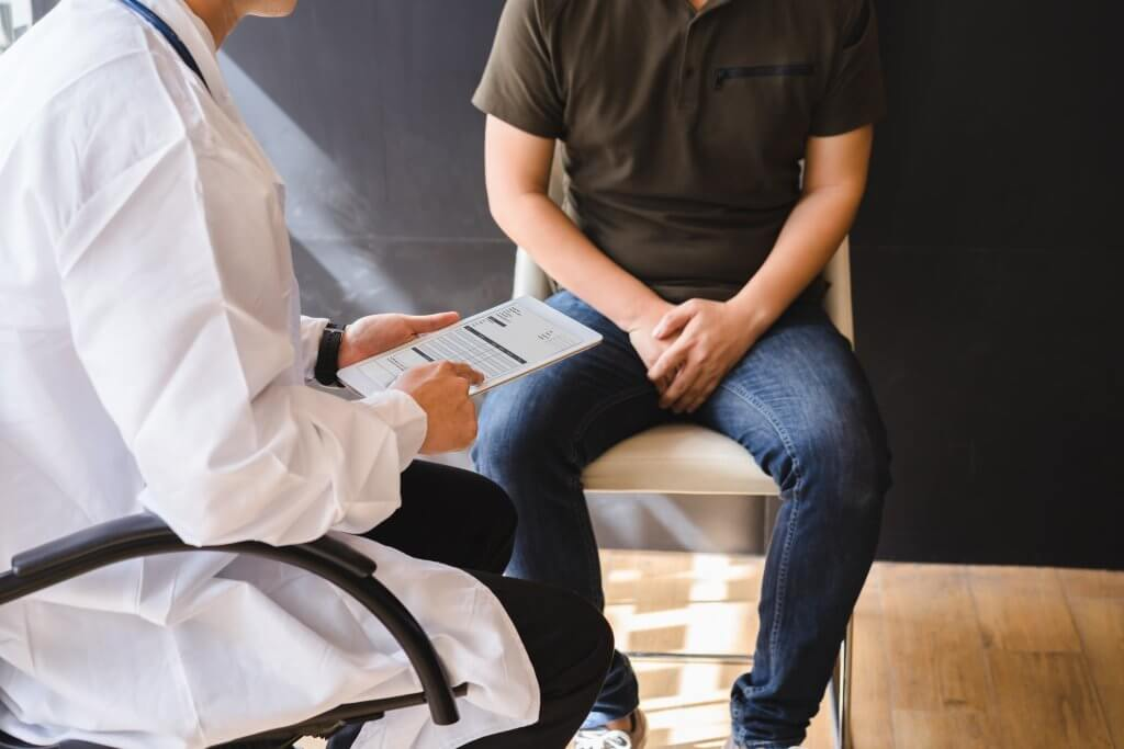 Male patient consulting with a doctor